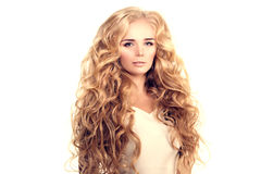 Model with long hair Blonde Waves Curls Hairstyle Hair Salon Upd Royalty Free Stock Photography