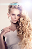Model with long hair Blonde Waves Curls Hairstyle Hair Salon Upd Stock Photos