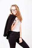 Model with long hair hold black jacket on white Stock Image