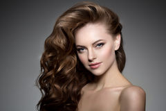 Model with long hair. Waves Curls Hairstyle. Hair Salon. Updo. F. Ashion model with shiny hair. Woman with healthy hair girl with luxurious haircut. Hair loss royalty free stock image