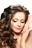 Model with long hair. Waves Curls Hairstyle. Hair Salon. Updo. F Royalty Free Stock Photography
