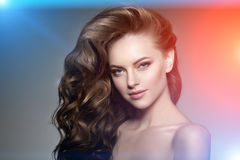 Model with long hair. Waves Curls Hairstyle. Hair Salon. Updo. F Stock Photography