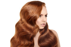 Model with long red hair. Waves Curls Hairstyle. Hair Salon. Upd. O. Fashion model with shiny hair. Woman with healthy hair girl with luxurious haircut. Hair Royalty Free Stock Image