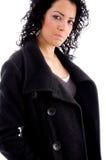 Model looking at camera wearing winter coat Stock Image
