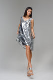 Model looking down and flirting in silver dress Royalty Free Stock Photo