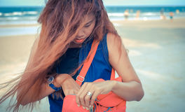 Model looking for something in hand bag. Royalty Free Stock Photos