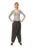 Model in loose wide trousers posing with arms on her hips Stock Photos