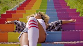 Model Lying On Colorful Stairs stock footage