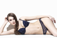 Model lying down and posing in underwear Stock Photography