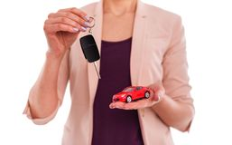 Model of the machine and car keys in female hands. Isolated on white background Royalty Free Stock Photo