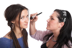Model and the make-up artist Stock Photos