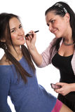 Model and the make-up artist Stock Photo