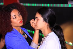 Model make-up artist backstage working Stock Images