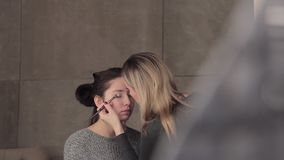 Model and make-up artist at work with eyes make-up stock video footage