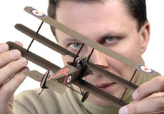 Model maker. Man holding paper model of World War 1 fighter (Sopwith Triplane Stock Photography