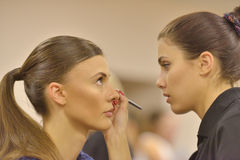 Model during makeup application Stock Images