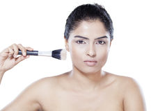 Model with makeup brush isolated Stock Photos