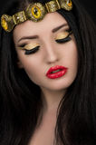 Model with makeup in golden crown Royalty Free Stock Photography