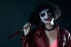 Model with makeup scary clown with knife Stock Photos