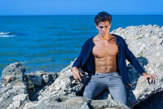 Model man with eyes green. Man dressed at sea under the sun Royalty Free Stock Photo