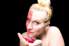 Model meets pomegranate Royalty Free Stock Images