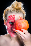 Model meets pomegranate Royalty Free Stock Photos