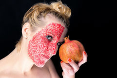 Model meets pomegranate Royalty Free Stock Photo