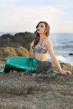 Model mermaid. An attractive girl dressed as mermaid by the sea Stock Photography