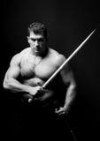 Model met een zwaard Stock Fotografie