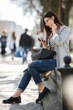 Model in the middle of the city with phone Royalty Free Stock Photography