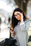 Model in the middle of the city with phone Royalty Free Stock Image