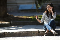 Model in the middle of the city with phone Stock Image