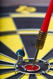 Model mini people walks towards the target on dart board. Royalty Free Stock Images