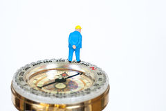 Model miniature on compass on white Stock Image