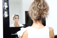 Model at mirror, make up concept Stock Photography