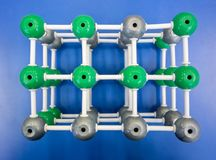 Model of molecular structure on blue background royalty free stock photo