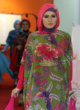 A model of Muslim wear during the fashion show Muslims in a bati Stock Photography