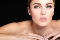 Model with no makeup and clean healthy skin face on black background. Beautiful woman model with no makeup and clean healthy skin face on black background Royalty Free Stock Photos