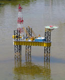 Model of oil rig platform standing on water Stock Photography