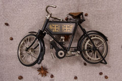 Model of an old bicycle. Model bicycle on a gray linen fabric Stock Photos