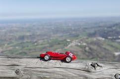 Model of old car and breathtaking landscape Stock Image