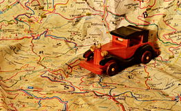 The model of an old car on the map Stock Image