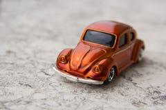 Model of old orange car. Toys: Model of old orange car Royalty Free Stock Photo