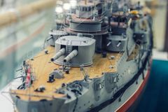 Model of an old warship. Close-up on the deck and towers of the main caliber of the ship royalty free stock photography