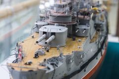 Model of an old warship. Close-up on the deck and towers of the main caliber of the ship royalty free stock photo
