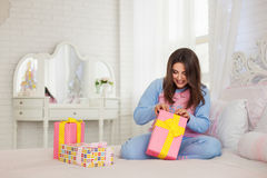 Model opening her New Year presents royalty free stock photography