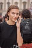 Model outside Marco De Vincenzo fashion shows building for Milan Women's Fashion Week 2014 Stock Images