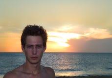 Portrait: Sunset men at the coastline royalty free stock photography