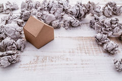 Model of paper house building with trash paper balls Royalty Free Stock Photos