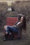 Model in a Park with an old chair Stock Image